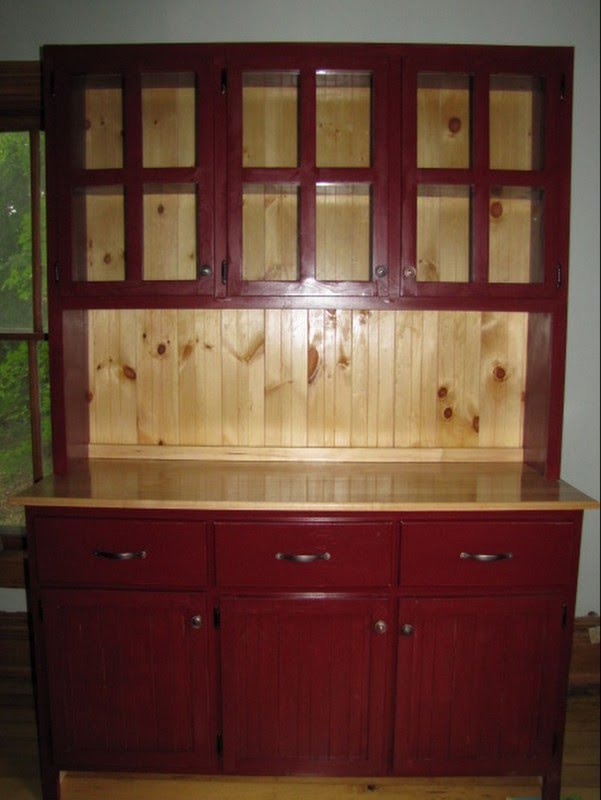 Fresh This pine and maple Kitchen Hutch has three drawers and cupboards on the bottom half The top half has a shelf and cupboards with a glass panel in each