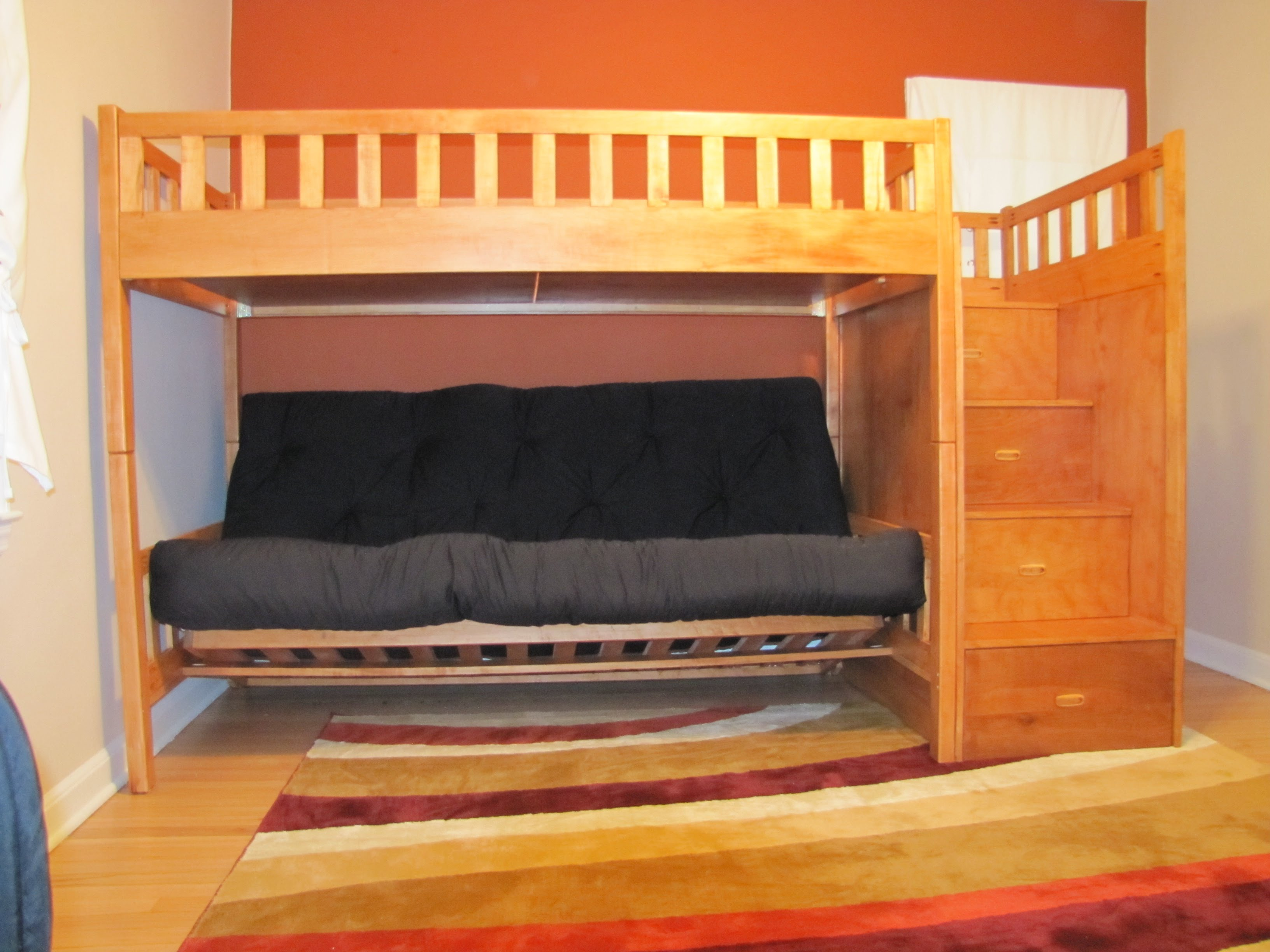 Luxury This maple piece is a twin XL over a queen futon The steps on the right are attached and fully functional This piece has a Salem Maple stain applied