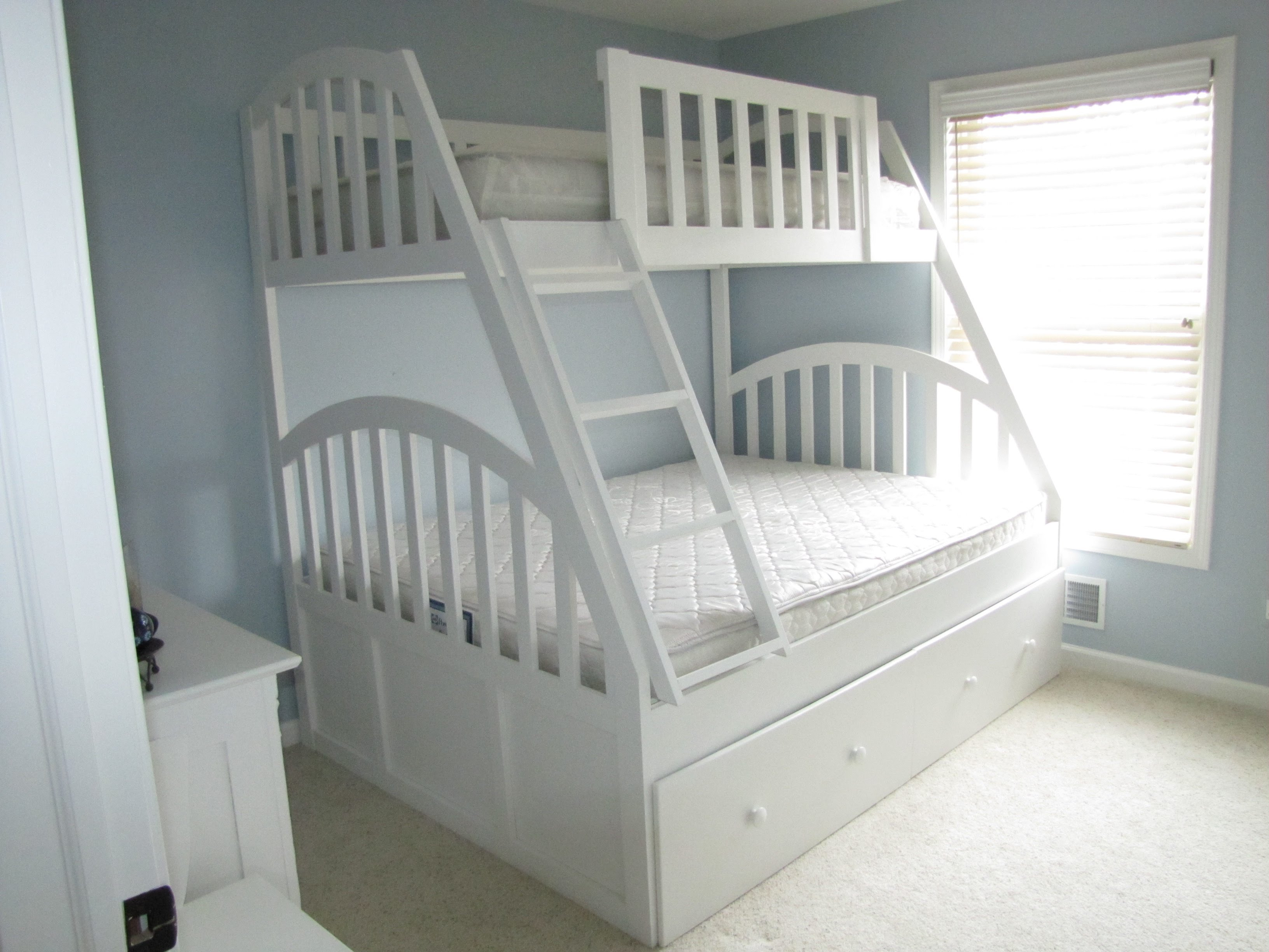 Marvelous This bunk bed is made of ash with walnut spindles and handles There are four drawers on both sides of the bottom bunk allowing the bed to be placed in more
